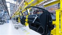 Industrial automaker's factory floor with assembly line and car doors